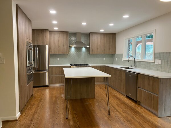 Newly remodeled kitchen with warmer color cabinets