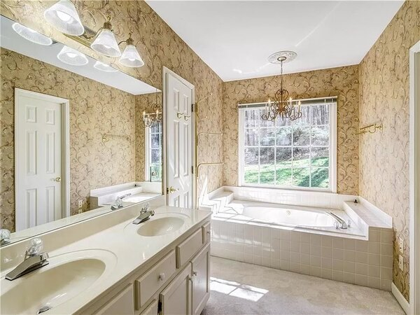 Other side of master bathroom before renovation